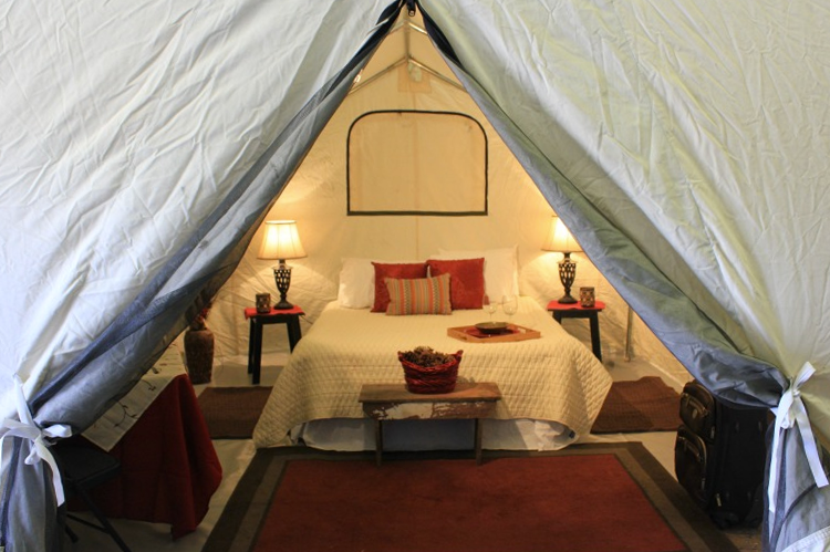 Image from https://www.outdoorsgeek.com/glamping-events/