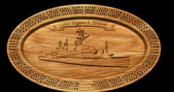 Some shipmates played Cribbage on one of the beautiful cribbage boards created by Rick Roy in the likeness of USS Eugene A. Greene.
