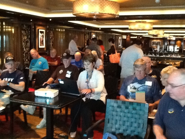 Seminar@Sea planners preparing for a meeting. Norwegian Cruise Line Group Marketing Director, Roz Young, in the white sweater.