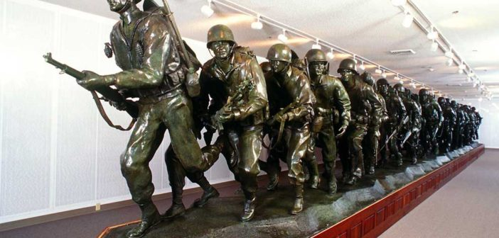 The world's largest bronze memorial statue was made by Fred Hoppe for the Branson Veterans Memorial Museum. Each figure in the WWII centerpiece is modeled after an actual combat soldier, one from each of the 50 states. Leading the charge up the beach is Fred's late father, Fred Hoppe, Sr., a highly decorated war hero. Valued at $3 million. Click thumbnail for full-size image.