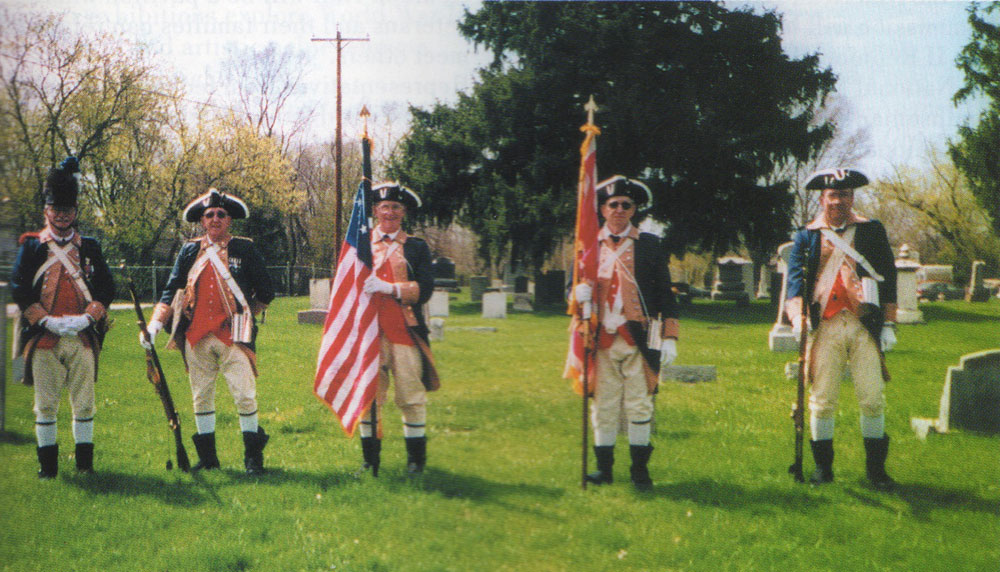 Re-enactors and a grave site. Photo by Peggy Gleich.
