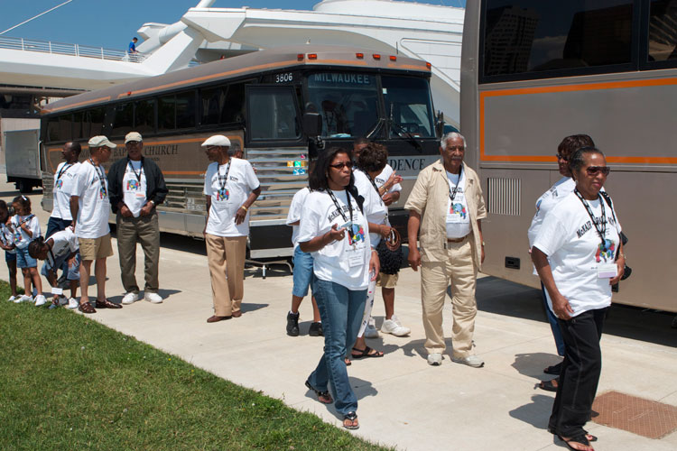 When the McNair-Brazil-Scott Family Reunion tours, they do so in chartered buses. Here they're arriving for a visit at the Milwaukee Art Museum on Lake Michigan.