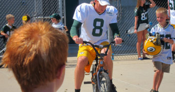 Tim Masthay (8) chooses one lucky little boy's bike to ride to practice.