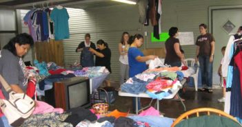 People look through items for sale at Class of '99 Garage Sale.