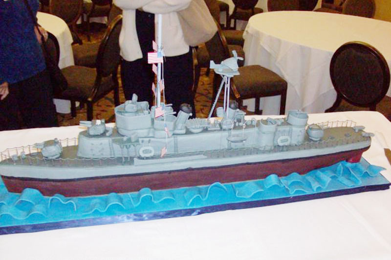 Reunion organizers for the USS Floyd B. Parks reunion added a festive touch to their catered dinner by having a local bakery bake a cake in the shape of the ship. Far more fun -- and more memorable -- than a standard sheet cake for dessert!