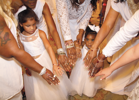 Darden, Rooks and Johnson Family Reunion women display bracelets created by Tara Powell Mack for their All White Banquet. Bracelets have angel wings on them honoring Mary Powell who LOVED family reunions. The two little girls are Mary's great grandaughters Kymze (left, 7) and Laila Shropshire (2).