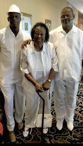 Martha Holt in the center, surrounded by her sons, Darren Olds (left) and Dennis Olds.