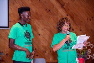 Carol Burger presenting scholarship to Tyrell Lampkin.