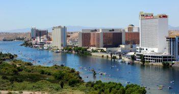 In this photo provided by the Las Vegas News Bureau, more than 20,000 people float down the Colorado River during the Bullhead City River Regatta in Laughlin, NV. Saturday, August 10, 2013. (AP Photo/Las Vegas News Bureau, Brian Jones)