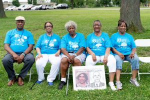 William Donaldson, Evie Mitchell, Dorothy King, Etta Ruth Rials, and Elnora Sled with picture of parents, Barbara and Sam Donaldson.