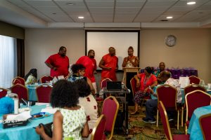 "Donald and Devin Stuckey and Patrick and Lisa Sled doing karaoke version of Gladys Knight and the Pips song ""Midnight Train to Georgia"" at meet and greet."