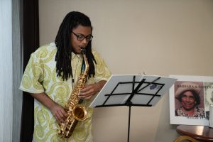 Saxophonist, Tyberius Livingston, entertaining at the for meet and greet.