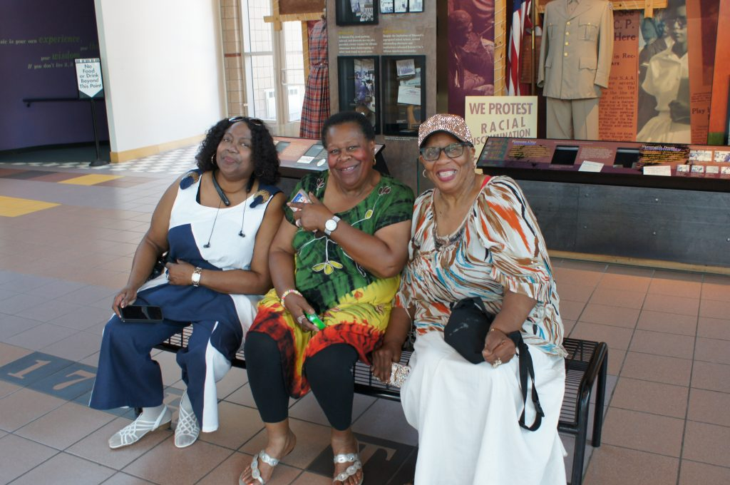 Juanita Lewis, Jessie Lee Brown and Doris Manning seated in lobby of Negro League Baseball and Jazz Museums in Kansas City, Missouri.