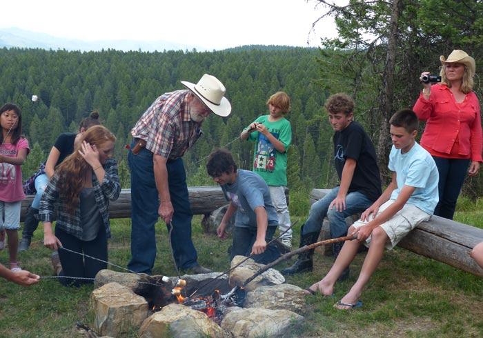 McClellan family roasting marshmallows at Bar W Ranch.