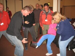 """Mark Birdseye, formerly of the program staff at YMCA of the Rockies, Snow Mountain Ranch, teaching a """"minute to win it"""" icebreaker at Family Reunion University."""