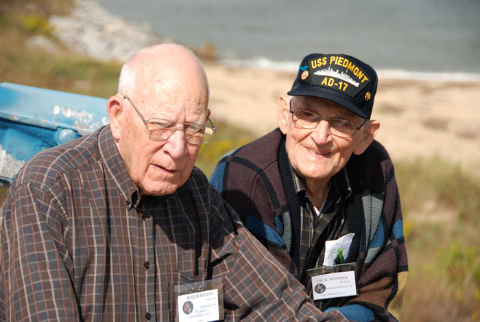 """Two PLANK Sailors (members of the original crew assigned to the Piedmont at commissioning in 1944 at the Tampa Shipyards): (left) Willis Bloyd, Seward, Nebraska (93, aboard 1944-45) and Cecil Whitmer, Goodlettsville, Tennessee (94, aboard 1943-46). Whitmer was assigned before commissioning and was aboard for the """"shakedown"""" cruise."""