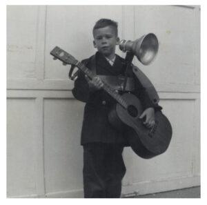 Joel Samberg at age eight performing at a family circle meeting.